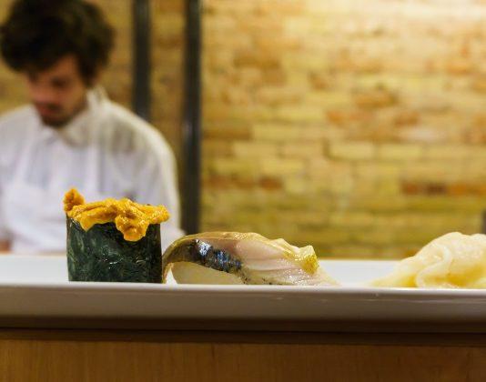 naked fish japanese bistro uni nigiri on sushi bar counter
