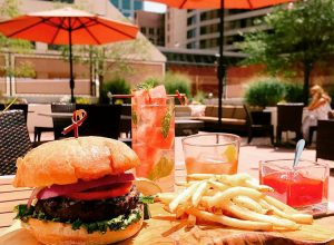 Spencer's - burger, fries and cocktail on the patio