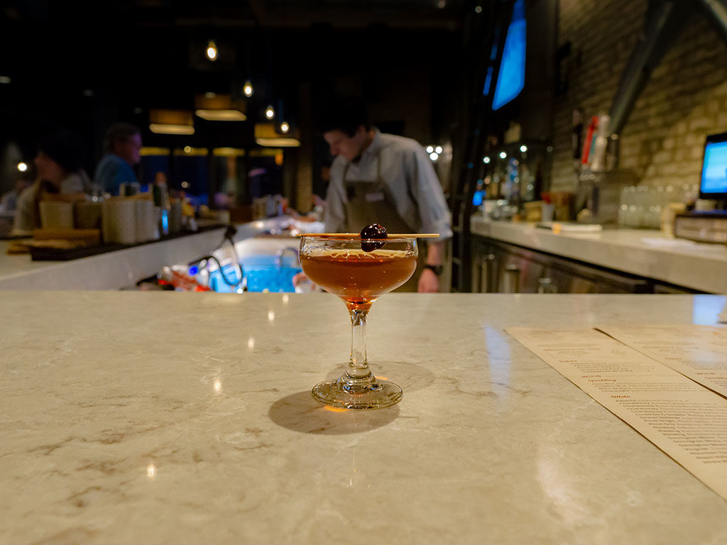 Hearth And Hill - Manhattan at the bar