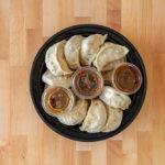 Happy Dumpling - dumplings with sauce