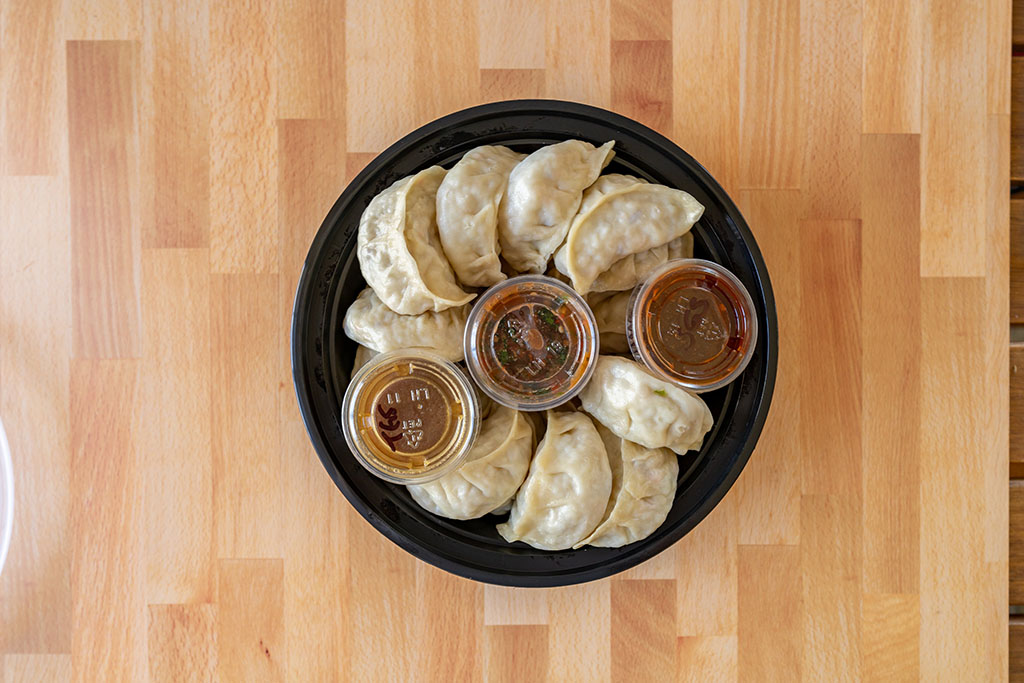 Happy Dumpling - dumplings with sauce